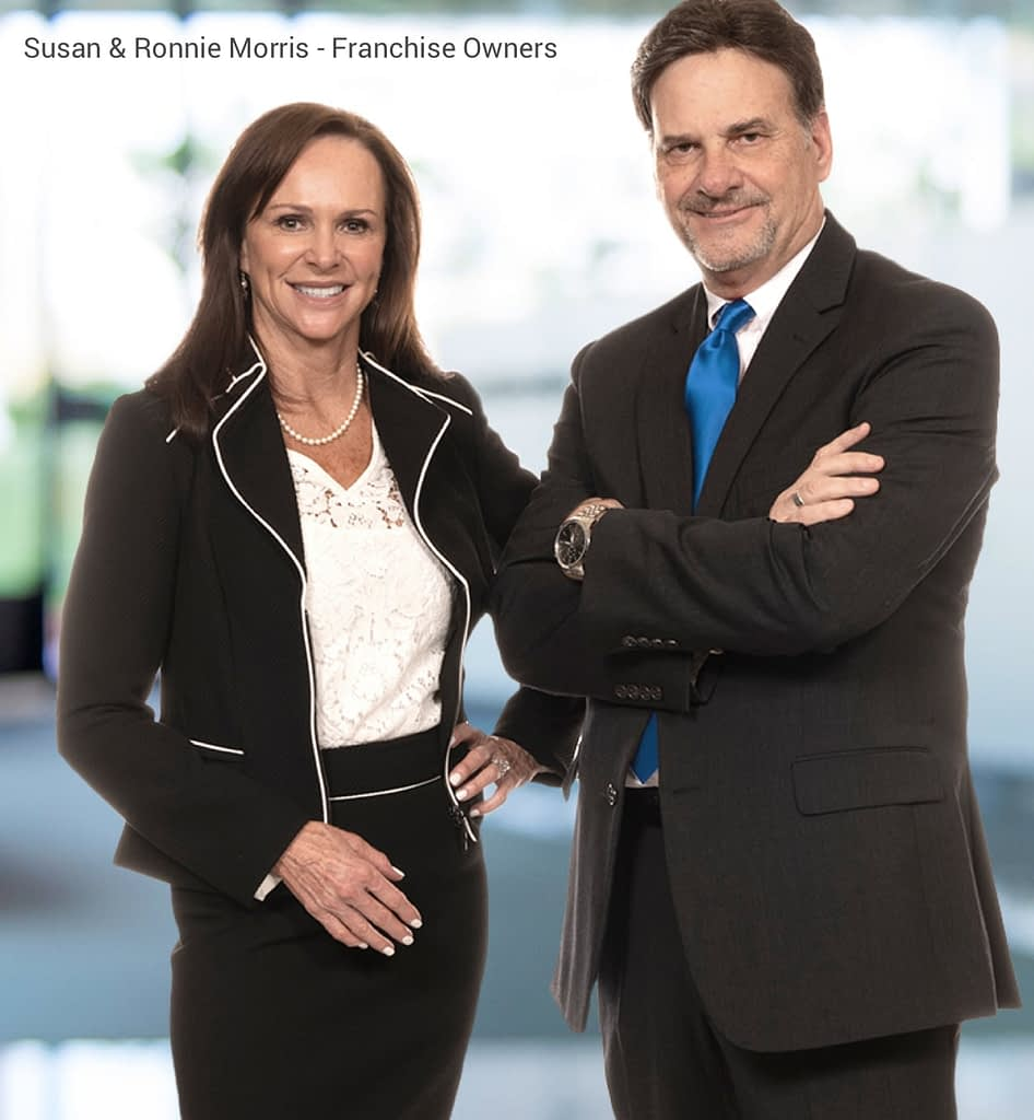 Image of franchise owners Susan and Ronnie Morris in professional attire