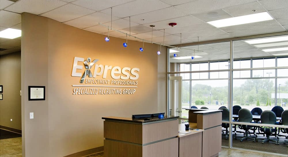 Interior image of a front desk in an Express office